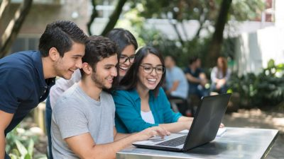 Group-of-students-at-the-university-using-a-laptop-computer2