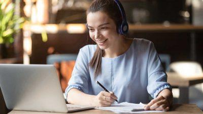 Smiling-girl-wear-wireless-headphone-study-online-with-skype-teacher2
