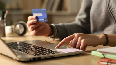 Student-hands-paying-with-credit-card-on-laptop-at-night2